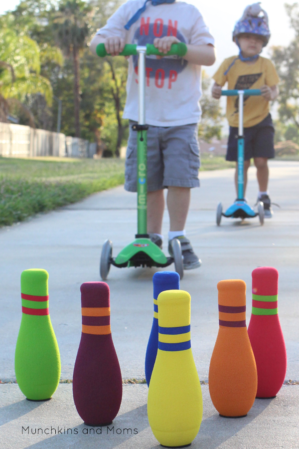 Scooter bowling- what a great outdoors activity for preschoolers!