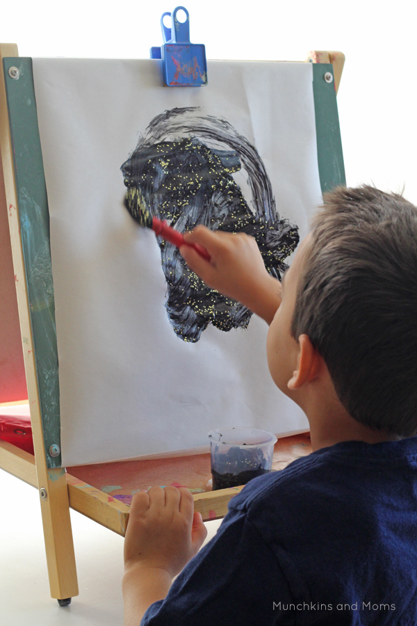 Invite kids to paint the starry night sky with this simple process art activity!
