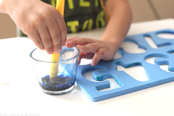 Make beautiful watercolors art with a foam numbers puzzle! Preschoolers and toddlers do great with this!
